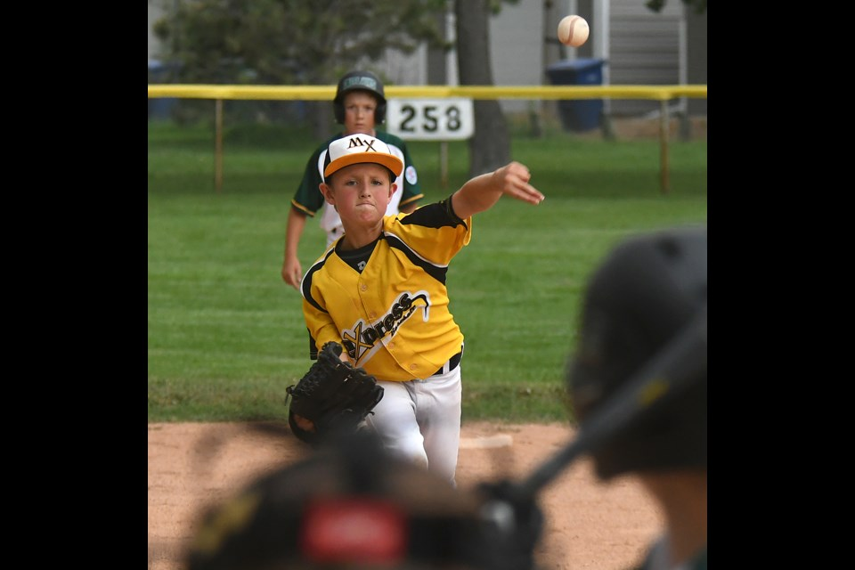 Rylan Gray delivers for the Moose Jaw Major AAA Miller Express early in Thursday's contest.