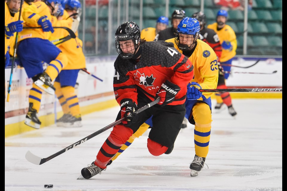 Team Canada's Corson Ceulemans carries the puck up ice against Sweden.
