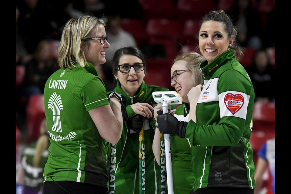 Team Saskatchewan shares a happy moment late in Saturday's contest. (Randy Palmer photos)