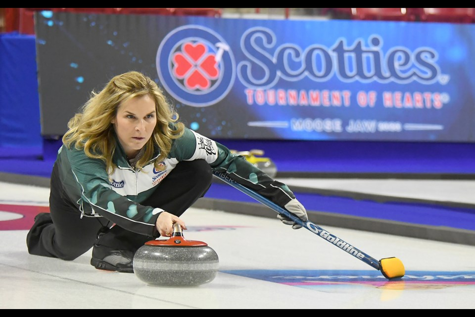 Jennifer Jones throws her first rock during practice Thursday night. (Randy Palmer photo)