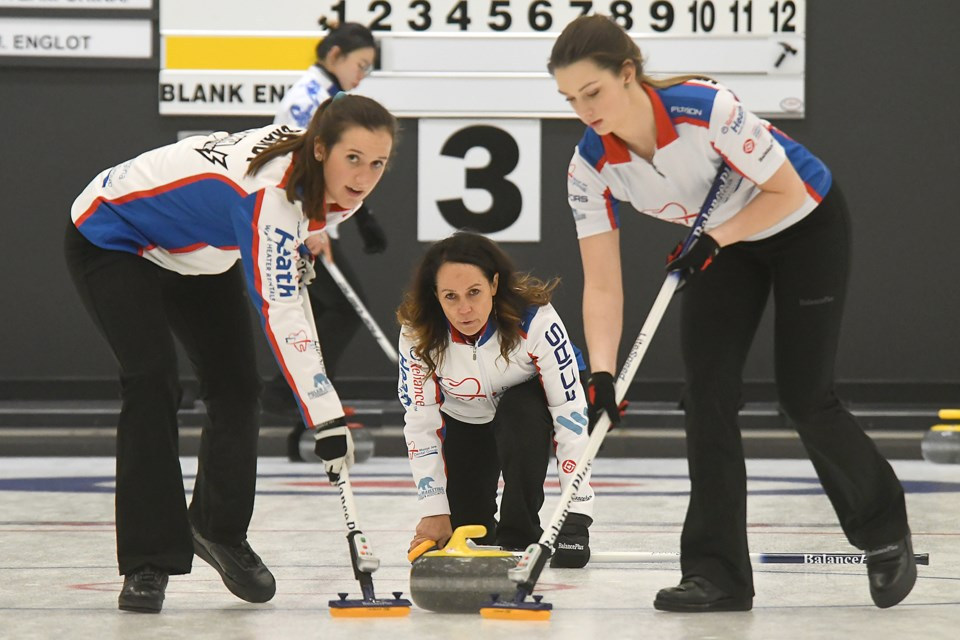 Michelle Englot delivers her first stone in the sixth end against Team China during the Saturday afternoon draw.