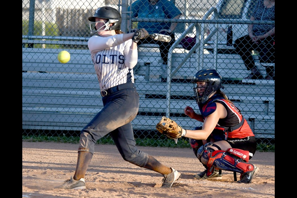 Mikayla Swallow fouls off a pitch.