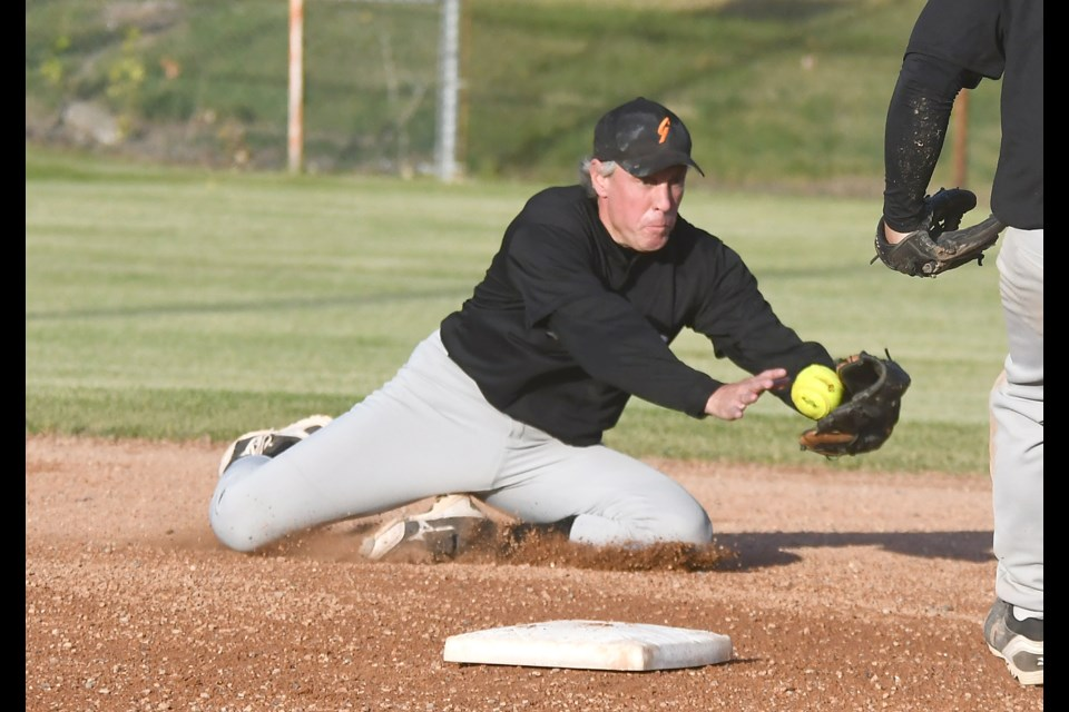 Giants shortstop Jason Schneider dives to get the force out at second.