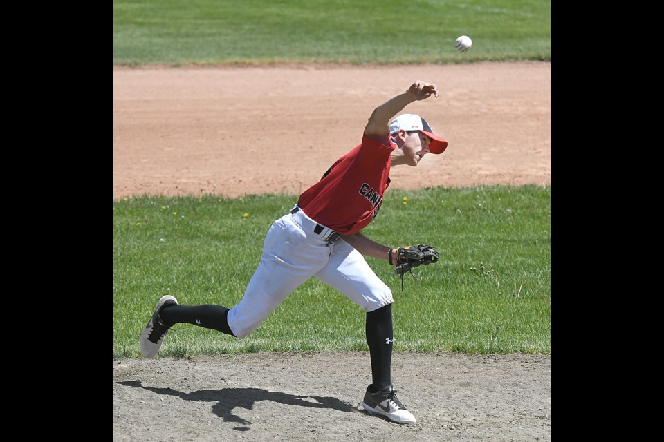 Canucks pitcher Kaedyn Banilevic delivers a pitch during third inning action.