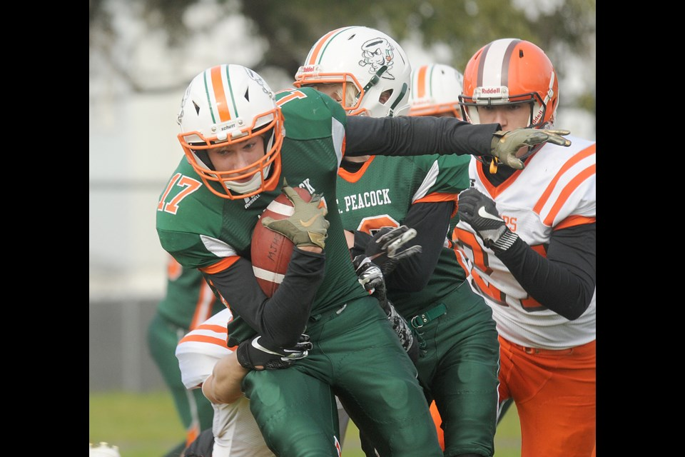 Peacock running back Drake Luebke attempts to break a Yorkton tackle during first-half action.