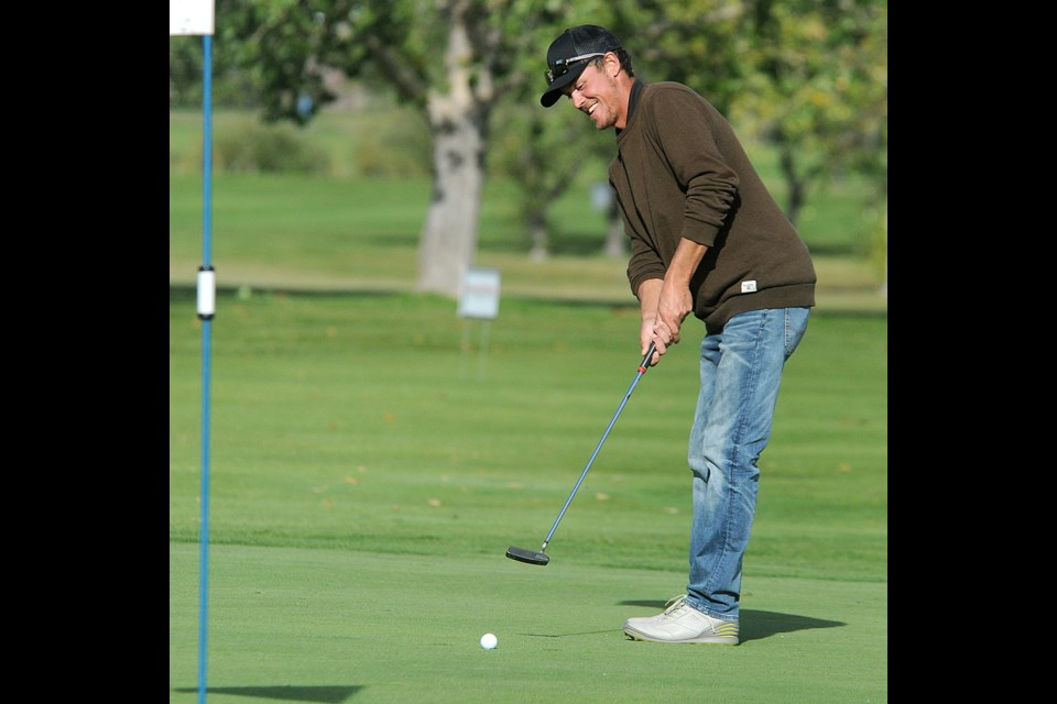 Brett Sentes cracks a smile as applause breaks out after he rolled his final putt to win the Carl Jorgensen tournament