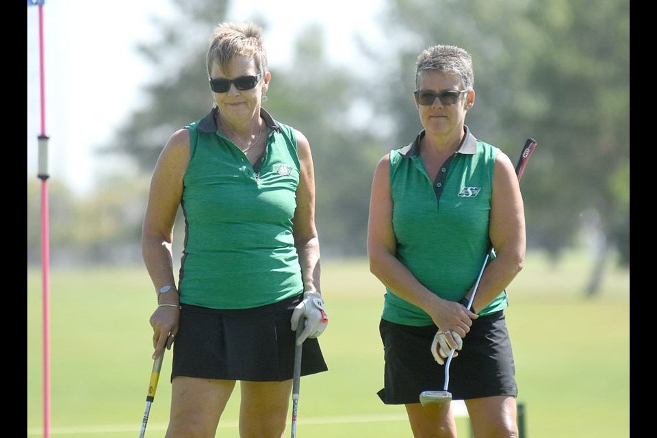 Fort Qu'Appelle's Sandra Williams and Lebret's Kathi McDougall look on during action from the 13th hole on Thursday.