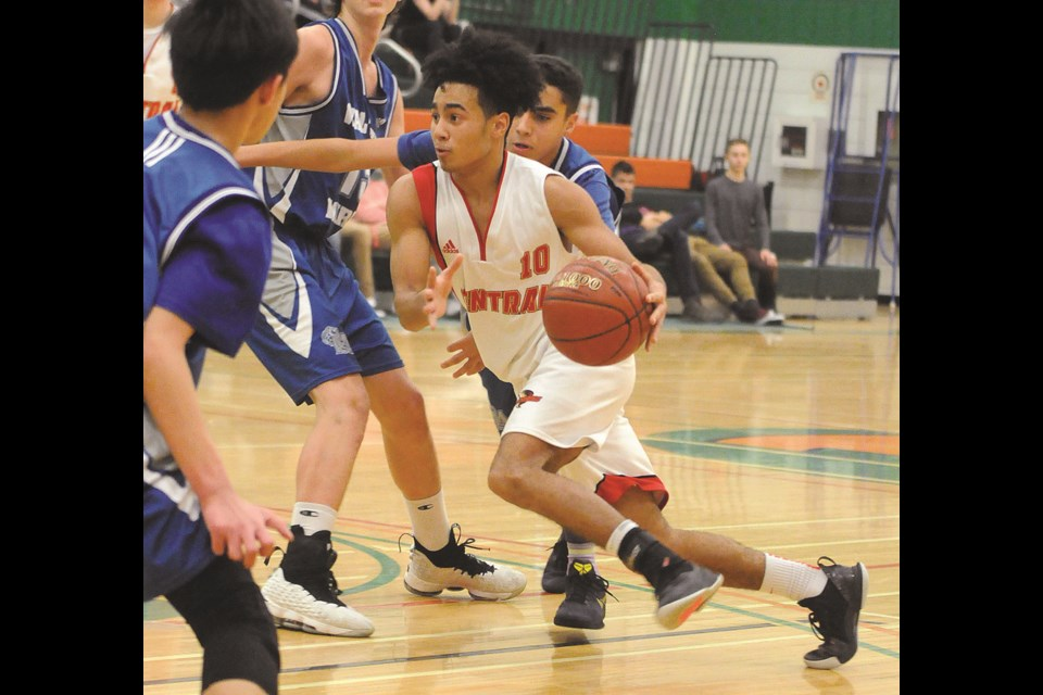 Central's Quinton Ross drives to the basket against Saskatoon Walter Murray during the championship final. Randy Palmer photograph