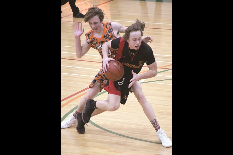 Central's Kael Nichols drives to the paint around Yorkton's Johntee Ostapowich.