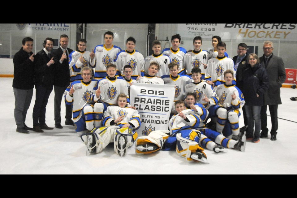 Players with the Prairie Hockey Academy gather for a team photo after their Prairie Classic tourney win. Randy Palmer photograph