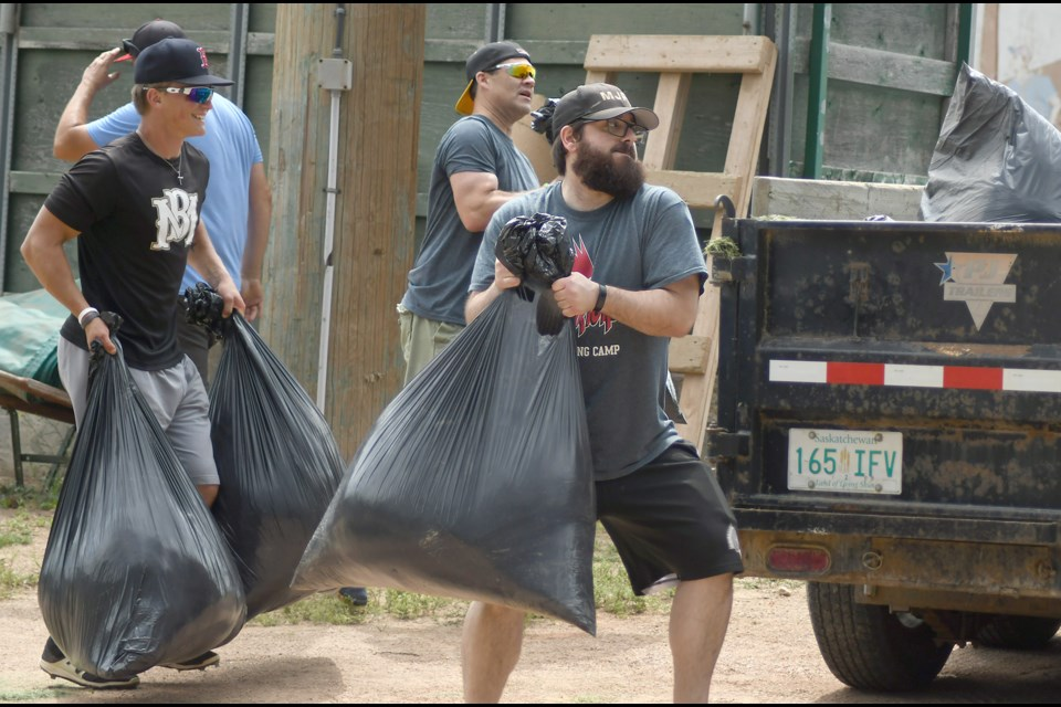 Moose Jaw Miller Express volunteer James Gallo was joined by general manager Cory Olafson and team president Darryl Pisio along with a crew of others working on Ross Wells Park on Saturday afternoon.