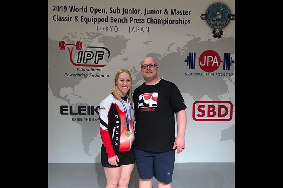 Moose Jaw's Rhaea Stinn pauses for a photo with husband and coach Ryan Stinn after being presented with her world bench press championship gold medal. Instagram photo