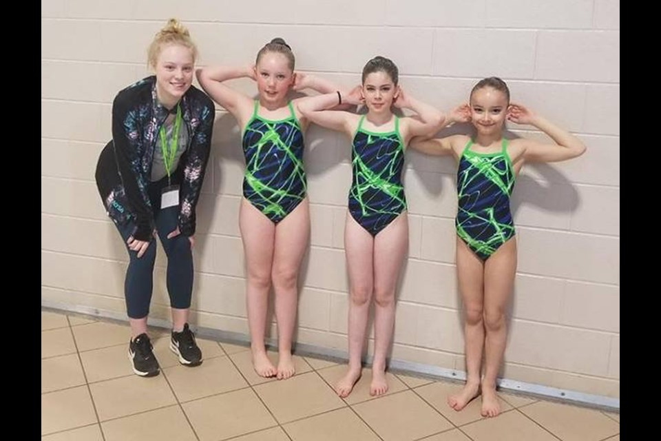 Alysa Beattie (coach),  Emily Boese, Ava Rosso, Macey Binsfeld took to the pool in the 10-and-under division.