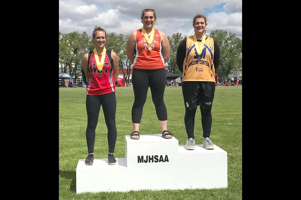 Vanier's Delaney Townsend on the podium after receiving her senior girls javelin gold medal.