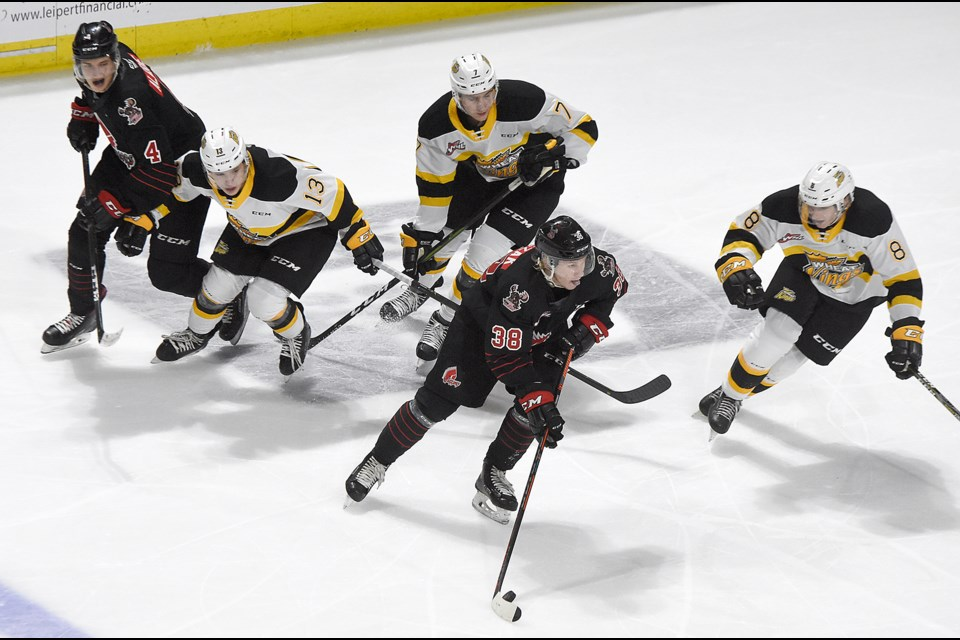 Warriors forward Ryder Korczak looks to find space in the Brandon zone.