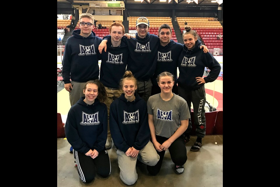 Kyle and Dylan Yamniuk pose with their Regina Advanced Wrestling Academy teammates at the Wrestling Canada national championships in Fredericton, N.B. Pictured are Alex Eisler (back left), Kyle Yamniuk, Dylan Yamniuk, Ben Bigelow, Jenna Petryna, Jada Baker (front left), Eve Neithercut and McKenna Ricard.