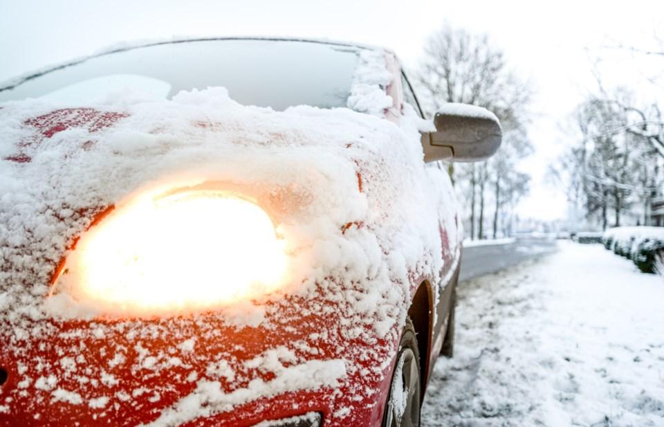 snow-covered-red-sedan-730901