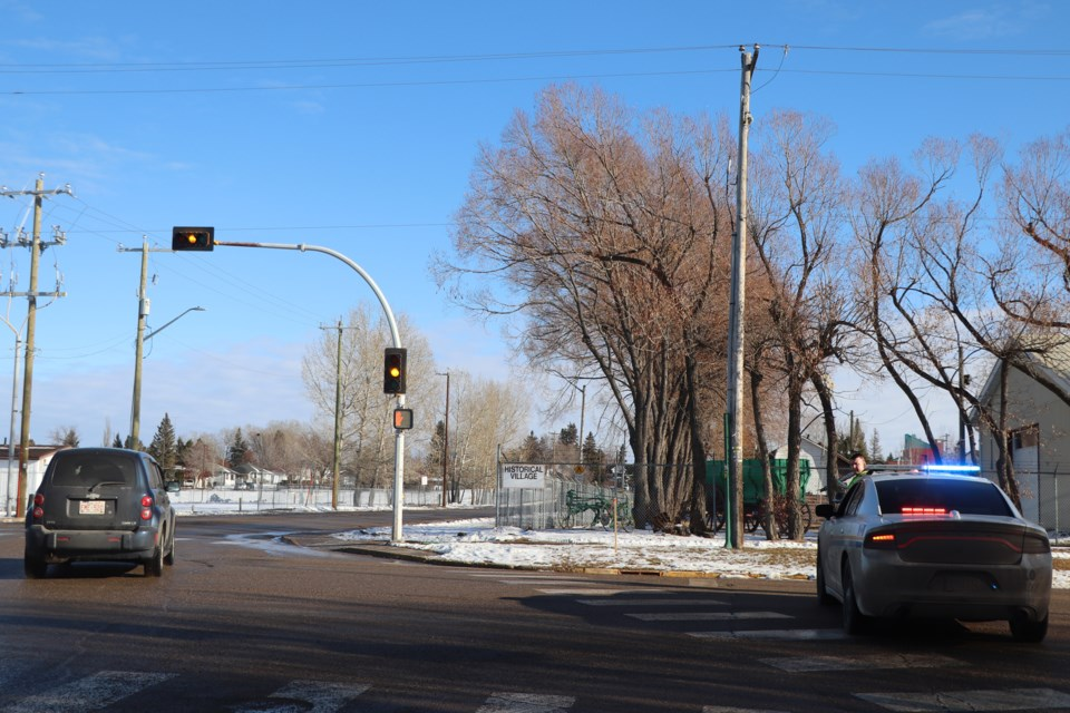 An Alberta Sheriffs Branch member blocks the southbound intersection of 52nd Avenue and 42nd  Street this afternoon during a police operation that resulted in the arrest of three suspects.