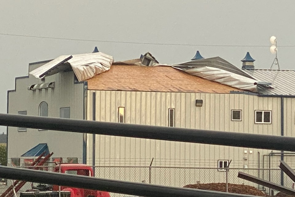 Powerful winds during the Friday, July 2 storm that swept through the area practically peeled almost the entire west-facing portion of the roof from the Town of Sundre's operations building. Photo courtesy of Shane Vollett