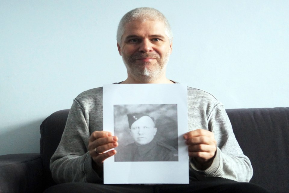 Belgian military researcher Niko Van Kerckhoven proudly holds up the photo of Bowden's Sgt. Norman Walter Gilliland, which he has been searching for since 2015. Submitted photo