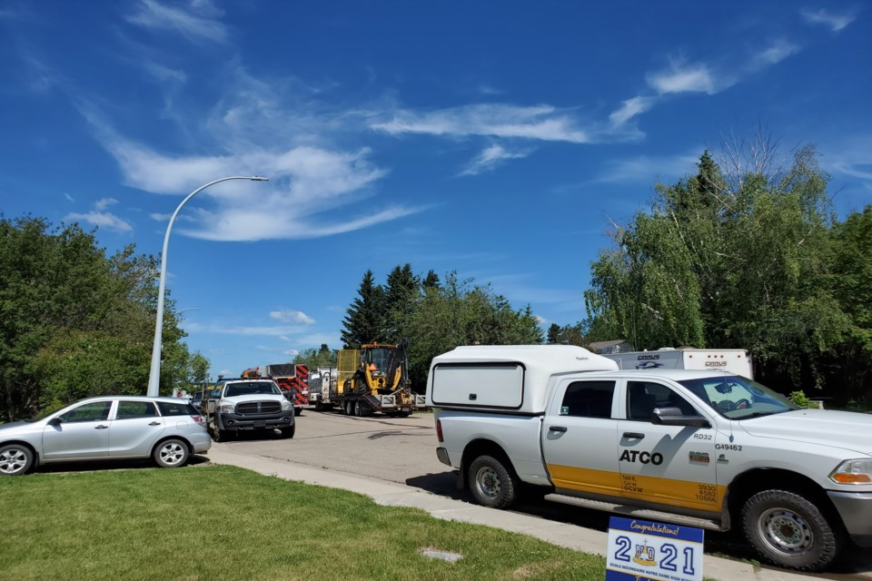 ATCO and local emergency responsers on 59th Street on June 25 following a reported natural gas leak on the property of mayoral candidate Glen Carritt. Submitted photo