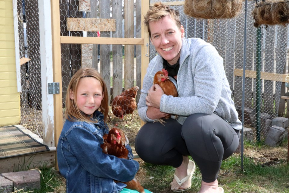 Lisa Reid and her granddaughter Izabelle were all smiles on May 11 when they brought their new urban hens home where they are now totally legal to raise in the Town of Innisfail. Johnnie Bachusky/MVP Staff