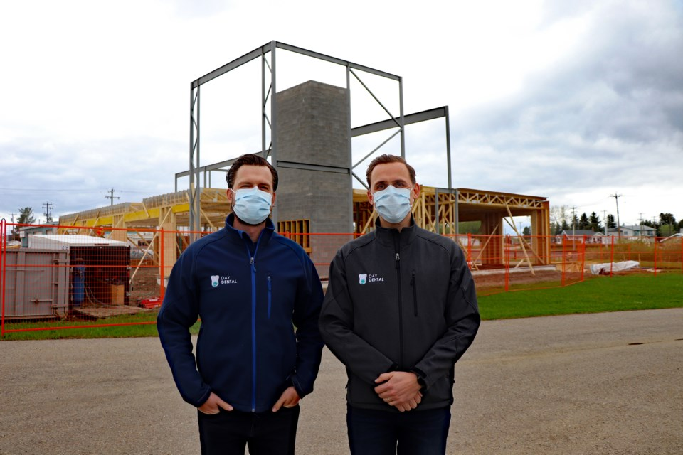 Dr. Isaac Day, left, and his brother Dr. Jacob Day in front of their new two-story home under construction beside the Henday Mall. The two dentists have served the town for the past decade. Johnnie Bachusky/MVP Staff