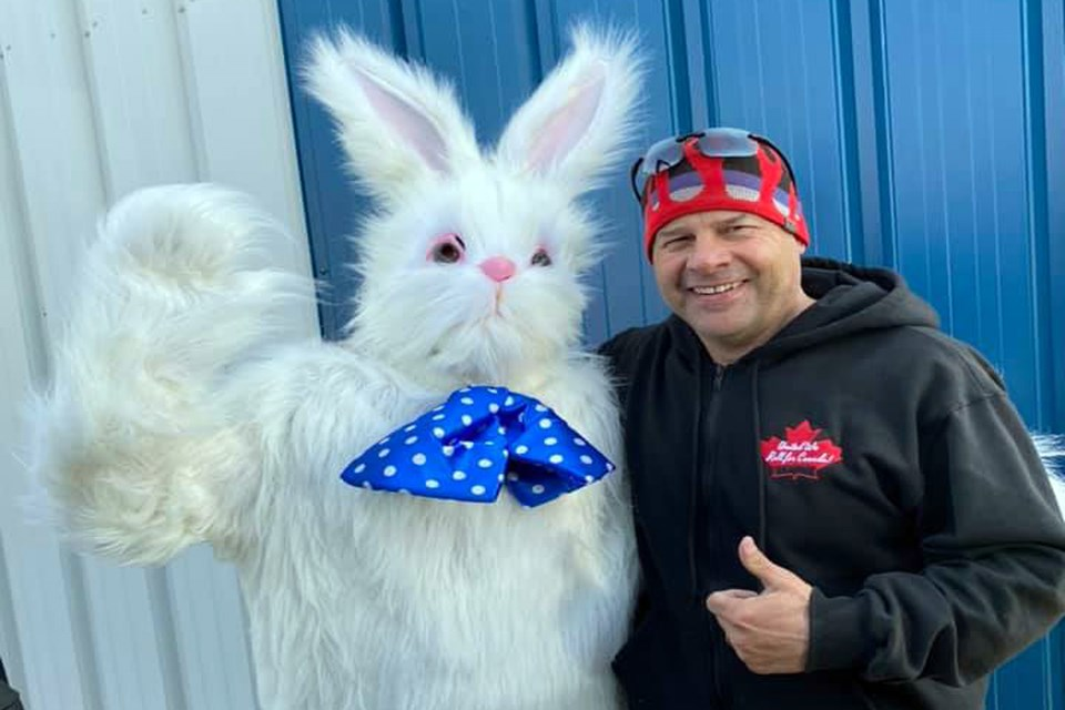 Innisfail mayoralty candidate Glen Carritt with the Easter bunny for his First Annual Spring Fever event on April 3. According to Carritt the two-hour outdoor event attracted more than 400 people. The RCMP and AHS are investigating to determine if the event violated provincial COVID-19 restrictions. Facebook photo