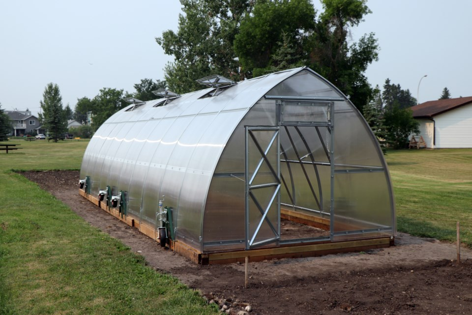 The new greenhouse at the Innisfail Community Garden. It was assembled last month by a group of committed volunteers. Johnnie Bachusky/MVP Staff