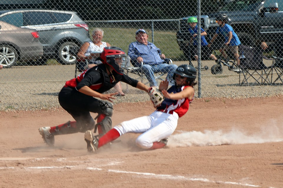 Catcher Seleah Organ of the Olds Pistols U16 squad puts the tag at home plate on Dylan Graham-Hunt of the Stettler Storm in first inning action during the July 17th game at the Innisfail Minor Softball Tournament.  Johnnie Bachusky/MVP Staff