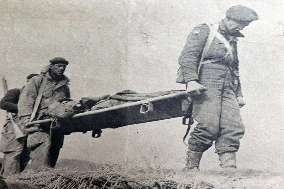 Pte. Russ Sutherland is carried off the Korean battlefield on a stretcher in this newspaper photo following his combat injury in February, 1951. Submitted photo