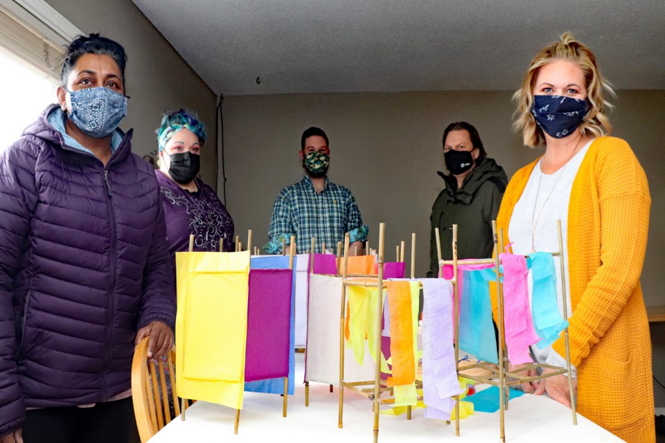 Volunteers step up to help for the inaugural Innisfail Lantern Festival in July. From left to right is Sue Haddow, Riki Findley, Shaun Steen, Jason Heistad and Crystal Kemp. Johnnie Bachusky/MVP Staff