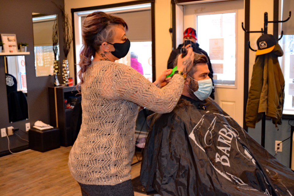 Natalie Klein gives her first haircut after re-opening her hair salon during the morning of Jan. 12. Johnnie Bachusky/MVP Staff