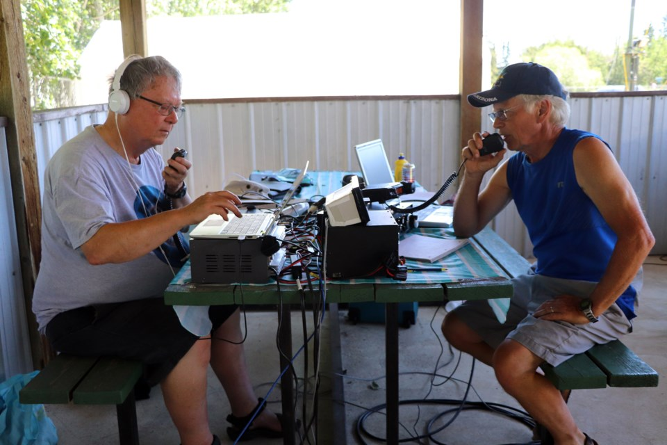 Red Deer's John Allen (left) and Lacombe's Bob King work the calls during the first hour of Field Day on June 26. Johnnie Bachusky/MVP Staff