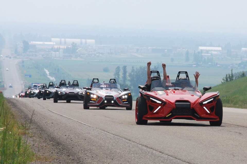 A convoy of roughly 20 Polaris Slingshots begins on Saturday, July 24 the second leg of the Sundre Slingfest's poker rally, heading northbound on Hwy. 22 to explore the area after enjoying lunch in town. Like so many others, last year's event was cancelled as a result of the COVID-19 pandemic.  Simon Ducatel/MVP Staff