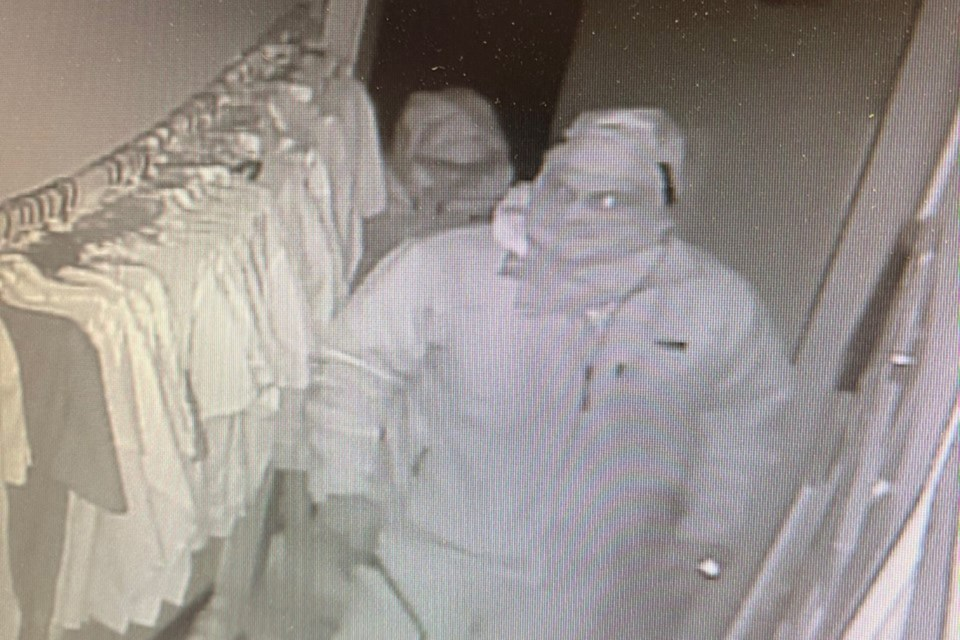 Break-in and theft suspects check out merchandise in the St. Matthews Anglican Church Thrift Store in Bowden.   Screengrab courtesy of Olds RCMP