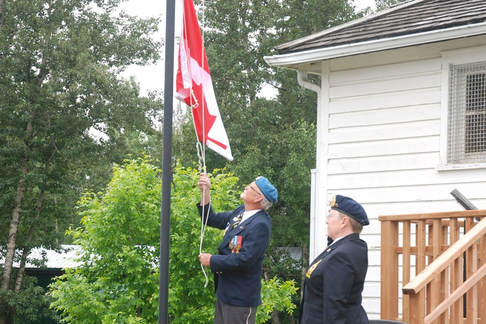Fred Gillies, a member of the Royal Canadian Legion Sundre branch 23, raises the flag during the brief Canada Day ceremony.  Simon Ducatel/MVP Staff