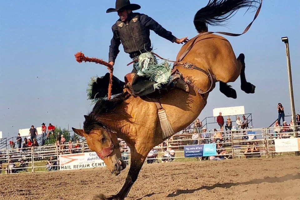Dallas Albertson, from Crossfield, scores a 75 in bronc riding during Bulls N' Broncs in Carstairs on Saturday, July 17. Dan Singleton/MVP Staff