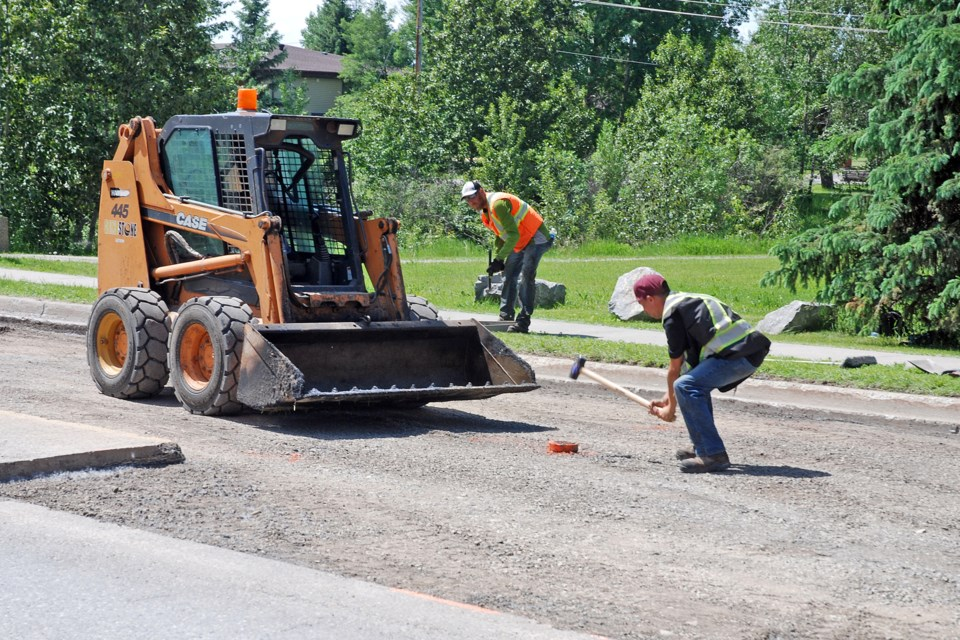 A crew with GrindStone Paving & Excavating was busy on Thursday, June 25 preparing to repave a severely degraded and pothole-laden portion of Centre Street.  Simon Ducatel/MVP Staff