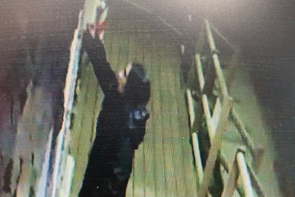 A still image from video surveillance recorded by a security camera installed at a building 4919, 53rd Street seems to have caught in the act a suspect accused of scratching the windows of numerous local businesses. 