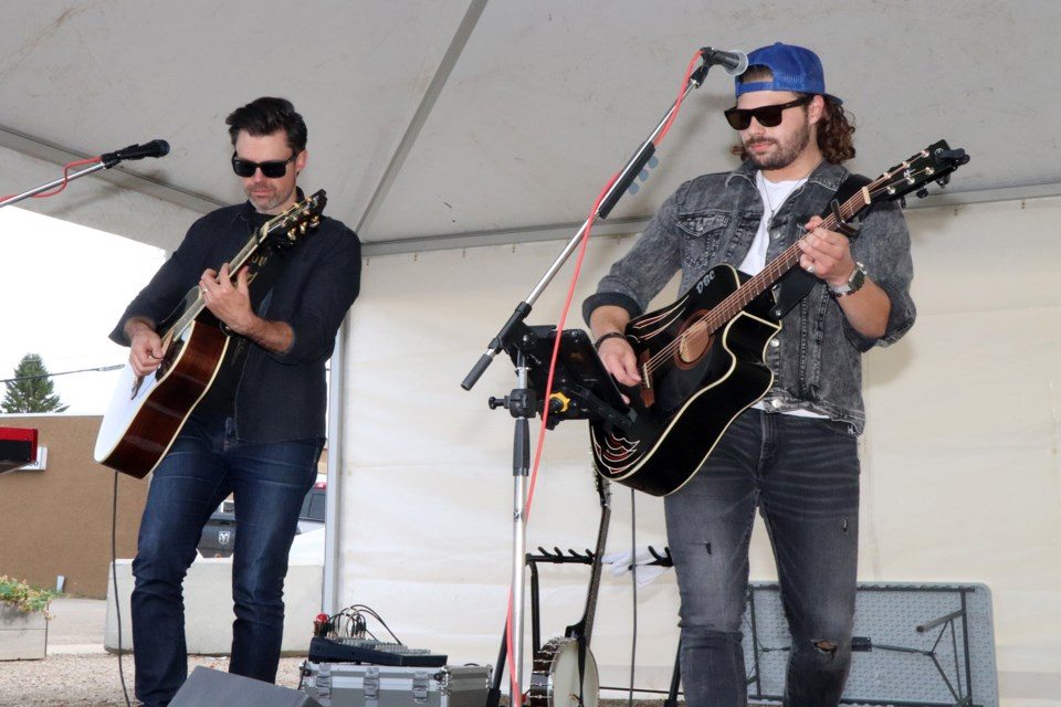 Local recording artist Devin Cooper, right, blasts out the tunes with Calgary's Brendan Waters during this year's final Market On Main in downtown Innisfail on Sept. 14. Johnnie Bachusky/MVP Staff