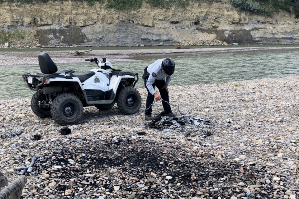 RCMP members returned to the Garrington Bridge area on July 26 to survey the damage from parties the night before. They found garbage and empty alcohol containers among other things.  Photo courtesy of Innisfail RCMP