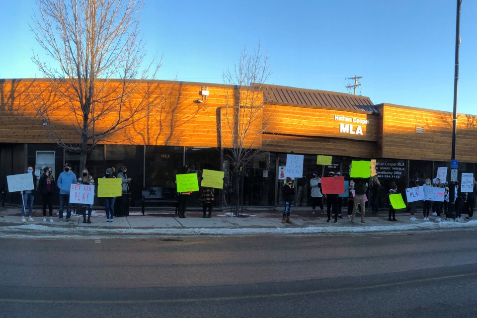 Parents and kids held a socially-distanced protest outside Olds-Didsbury-Three Hills MLA Nathan Cooper's Olds constituency office on Jan. 18.