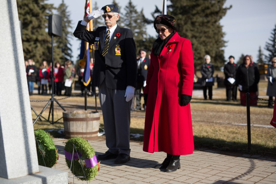 Tom Bartholow, left, and Valerie Braiden lay wreaths at the cenotaph during the ceremony. Noel West/MVP Staff