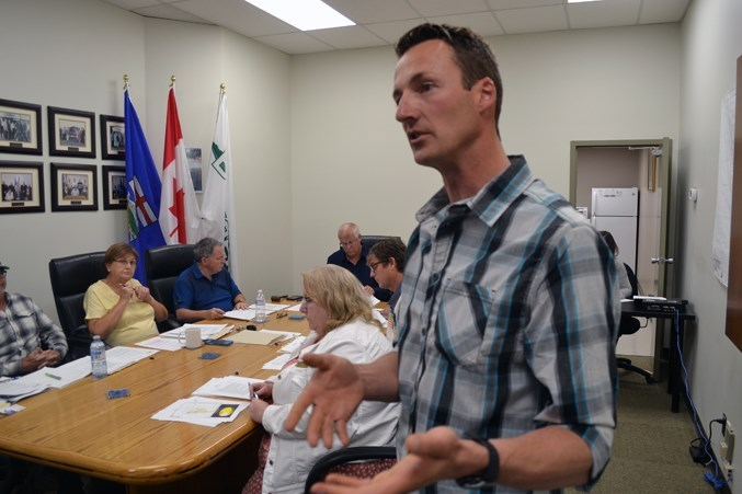Developer Kyle McCowan of Okotoks states his case for the Lions Hall project during a public hearing in Bowden. File photo