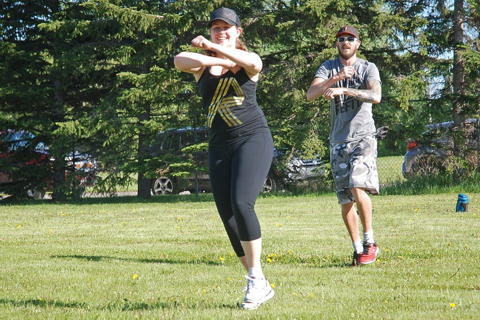REFIT Sundre participants Ellen Bunn and Jeff Boettger joined on Wednesday, June 10 a group of more than a dozen people who came out to the Sundre Rodeo Grounds for the kick-off to outdoor classes. With all of the available space at the grounds, people easily maintained physical distancing while enjoying some exercise.   Simon Ducatel/MVP Staff