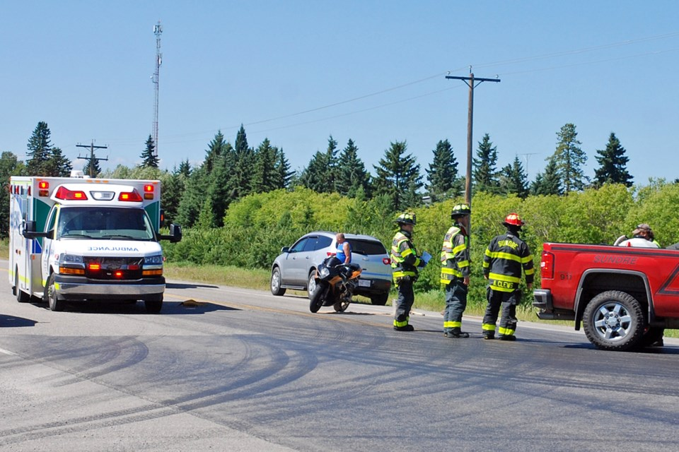 The Sundre Fire Department, along with a ground ambulance crew, were quick to respond to a report that a motorcyclist had lost control and skidded out while turning westbound onto Highway 27 from Rge. Rd. 51. Simon Ducatel/MVP Staff