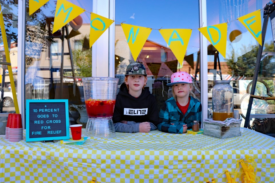 Sullivan Robin, 9, and his seven-year-old sister Nona, right, are giving 10 per cent of their earnings from Lemonade Day to help fire victims in British Columbia.  Johnnie Bachusky/MVP Staff