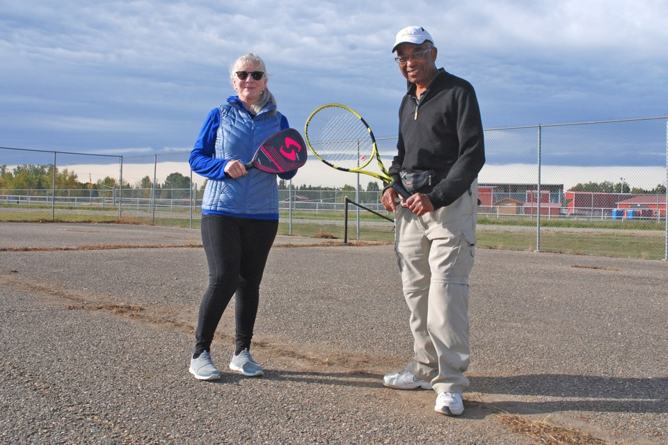 Longtime Sundre residents Brenda Salsman and Anton Walker met up at the tennis court behind the Sundre High School on Friday, Sept. 25. Salsman recently started raising funds with the goal of resurfacing the court in the spring.