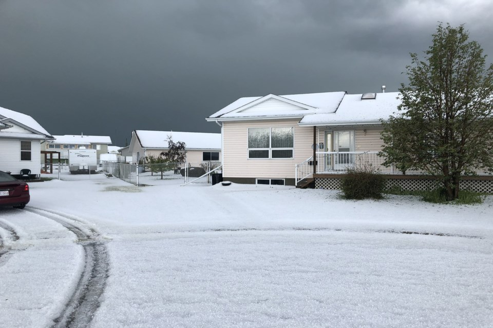 Hail blankets the ground on 44th Avenue Close in Innisfail on July 12 after a storm swept through. Photo by Marlowe Harrowby Photo by Marlowe Harrowby